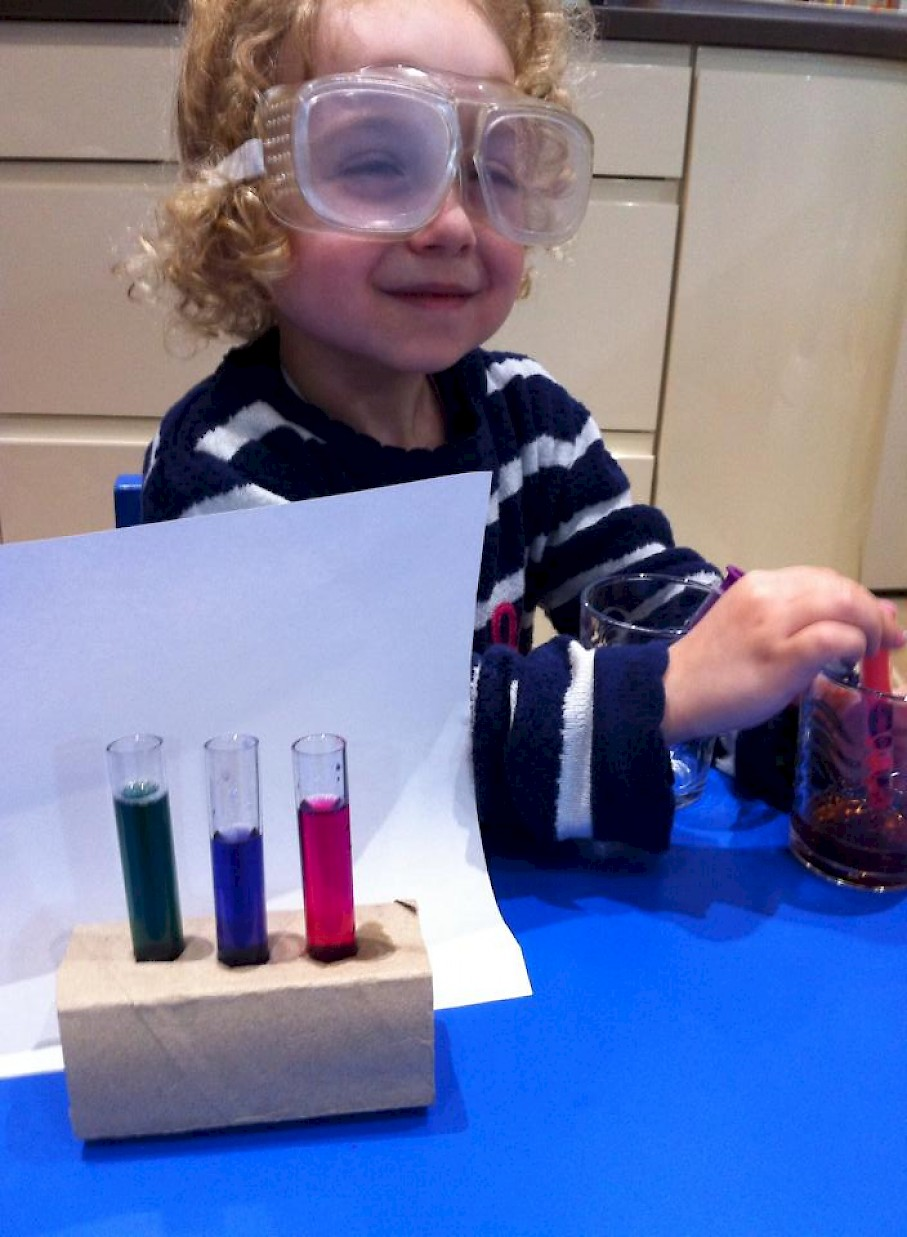 Test tubes filled with different coloured liquids